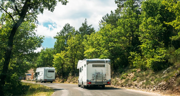 rvs driving along highway in summer