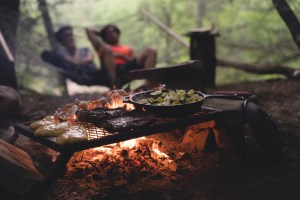 rv campfire cooking couple romantic
