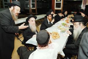 Kiryat Gat Mashgiach Rabbi MM Groner (L) with guests