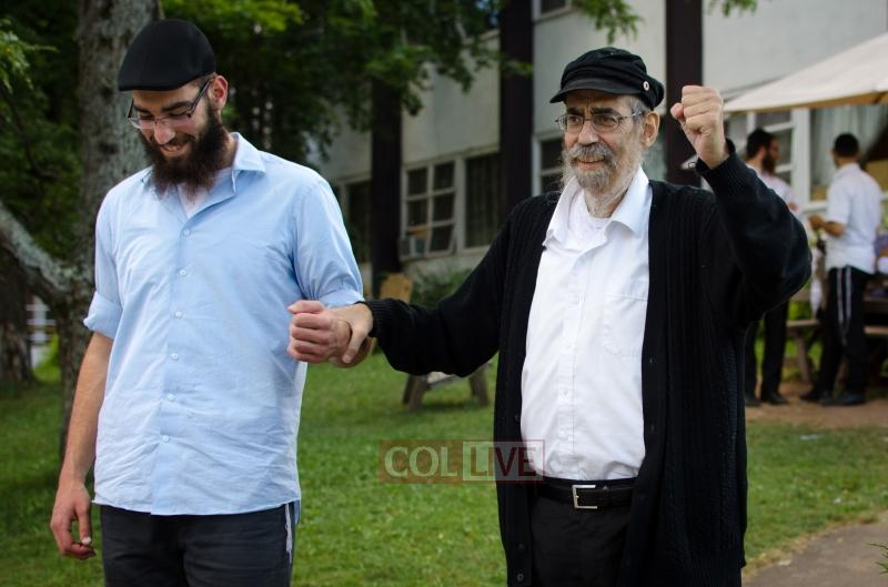Rabbi Aaron Eliezer Ceitlin encourages singing at Camp Gan Israel Parksville with his son Heshy