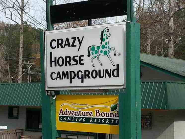 Adventure Bound Camping Resorts Crazy Horse Campground in Gatlinburg Tennessee Sign