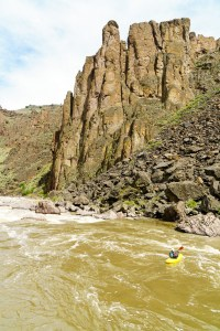 Daphnee Tuzlak drops in to the first rapid through the other-worldly terrain of the Middle Owyhee.