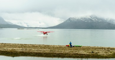 Malkolm Boothroyd watches the float plane land as it brings in our second group of paddlers.
