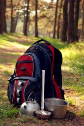 Hiking gear on forest path