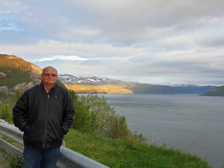 James standing in the midnight sun norway