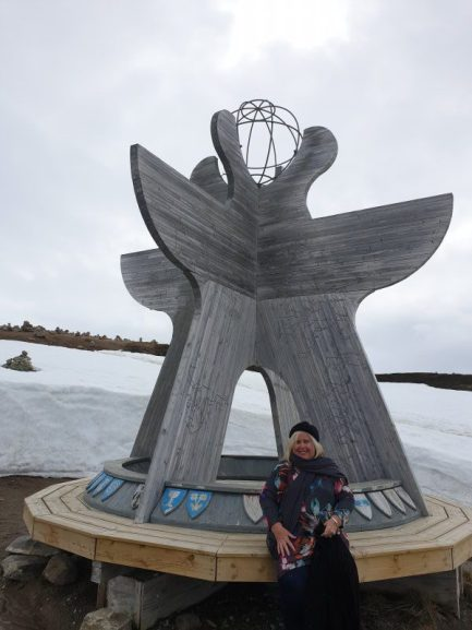 Nicole Anderson at one of the arctic circle markers Norway