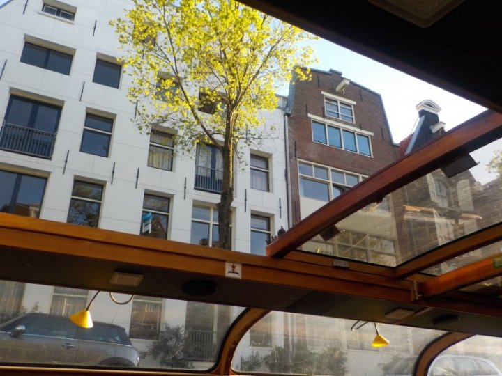 As we went through some of the more narrow canals, the street buildings seem to tower above our boat.