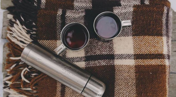 blankets-and-flask (Shutterstock, Maria Evseyeva)