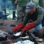Paul demonstrating his expertise at Dutch Oven Cooking.