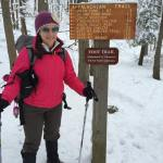 CampingMeg next to a rare to a trail sign showing mileages. This sign is a rare luxury for Harriman.
