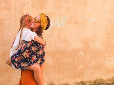 mum-carrying-daughter