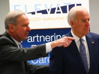 DMACC President Rob Denson and Vice President Joe Biden tour Building 3E on Thursday, Feb. 12