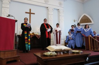 Church altar filled with ministers and choir