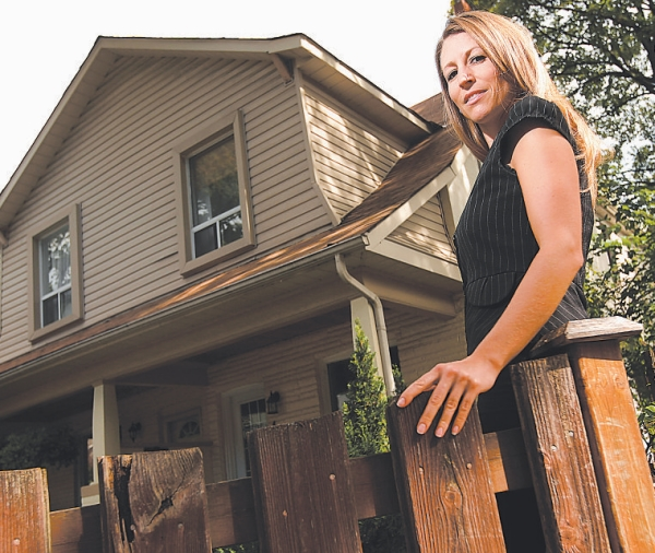 Toronto real  estate investor Cindy Wennerstrom at one of the seven properties she  rents out. She's in the process of buying an eighth property, but is