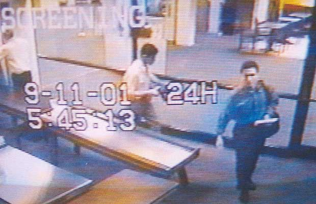 A surveillance camera photographs two men identified by authorities as suspected hijackers Mohammed Atta (R) and Abdulaziz Alomari (C) as they pass through airport security September 11, 2001 at Portland International Jetport in Maine.