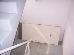 Stairwell door ripped off its hinges, placed in stairwell temporarily until fixed
