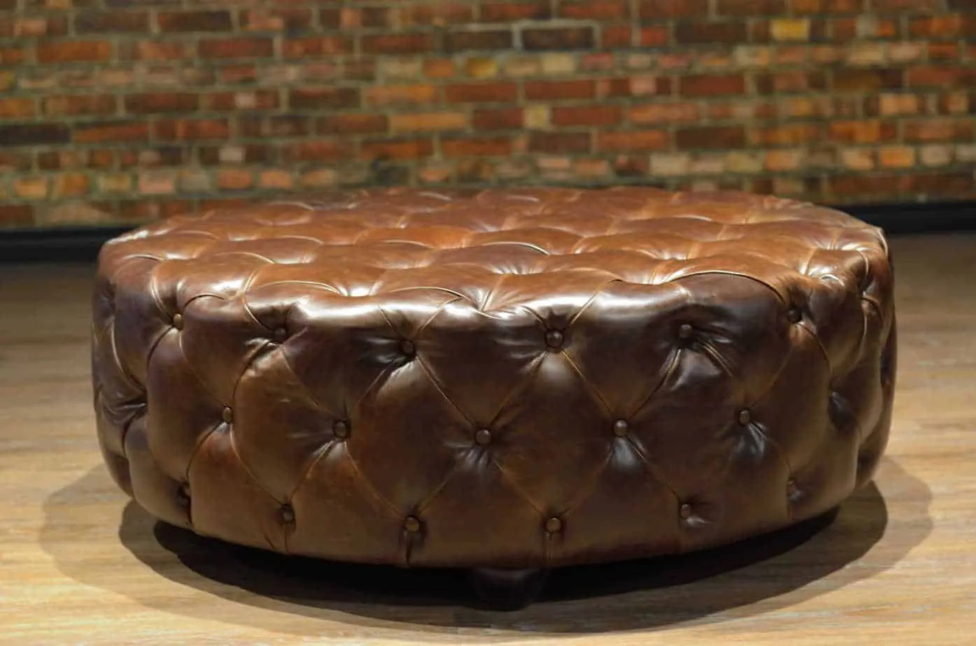 the king arthur round leather tufted ottoman collection