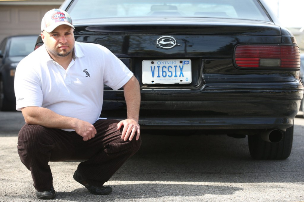 "[Daniel D'Aloisio poses with his ""VI6SIX"" licence plate.]"