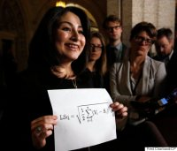 [Photo of Maryam Monsef holding up a sheet of paper with the equation for the Gallagher Index of election proportionality on it (which is just a simple least squares regression).]