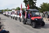 [Photo of a parade float consisting of a golf-cart pulling a train of large posters displaying anti-abortion messages.]