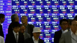 Asian Shares Boosted By Strong Dollar But Commodities Hit