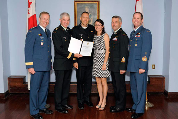 Captain Harold Ristau, CAF Recognition Program recipient, with his spouse Elise Ristau, receives a Chief of the Defence Staff Commendation from Vice Chief of the Defence Staff Lieutenant-General Guy Thibault, accompanied by Major General David Millar, Chief Warrant Officer Pierre Marchand, and Chief Warant Officer Kevin West, at the Sergeant's mess in Ottawa on May 31, 2014