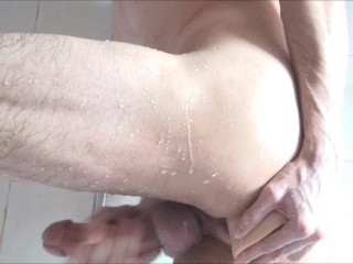 Guy takes Thick Dildo under Shower