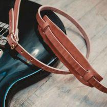wood_faulk_correia_guitarra_couro