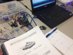 Course Handbook with Joystick ECU in the background
