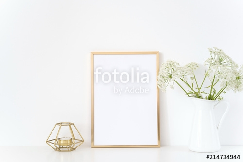 gold frame mock up with a aegopodium in jug and candle mockup for
