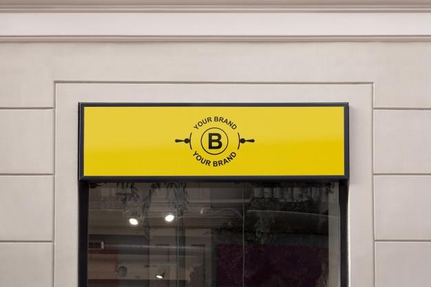 logo mockup on facade or storefront psd file free download