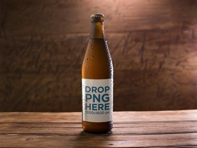 placeit amber weizen beer bottle template on a wooden surface