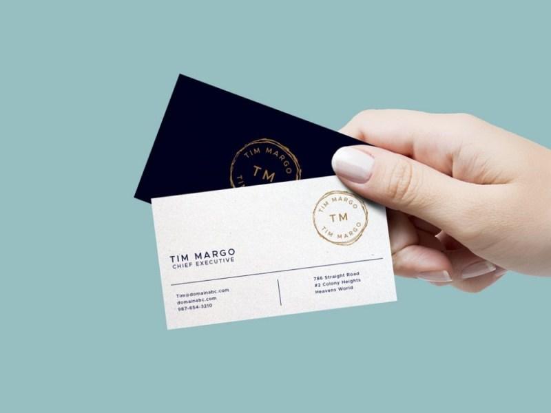 female hand holding business cards mockup mockupworld