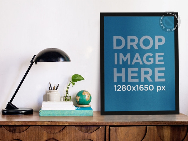 placeit mockup template of a poster standing on a wooden desk
