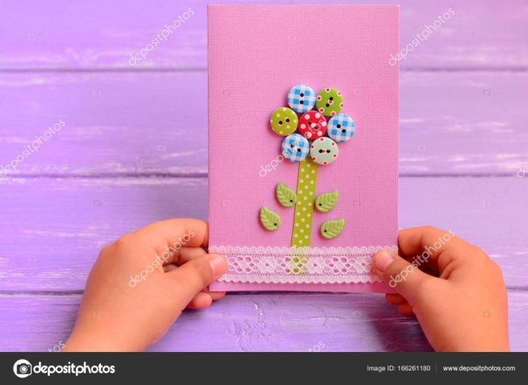 child made birthday card ideas child holds a flower card