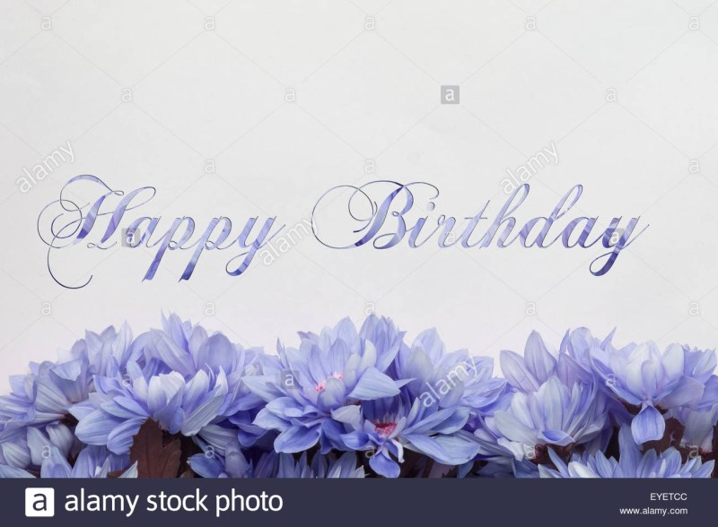happy birthday greeting card flowers and text stock photo