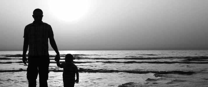 Person and Child in Sea