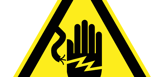 warning sign showing electrical current making contact with hand