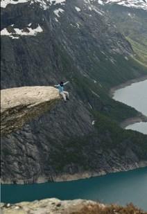 Sitting on Trolitiunga Rock in Norway