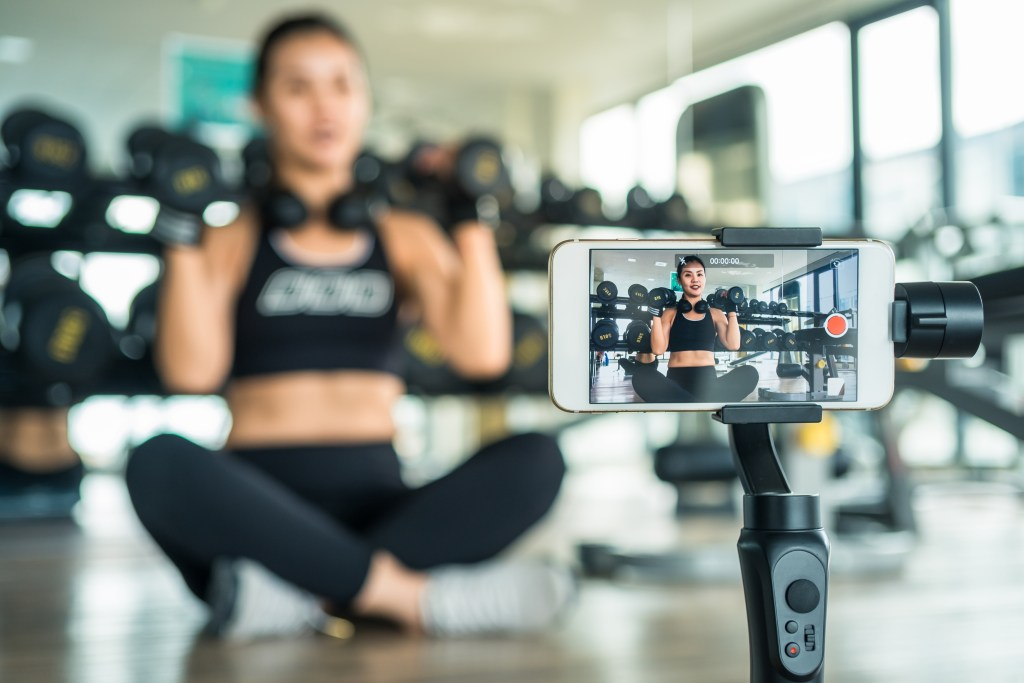 woman shooting video on phone