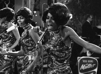 """The Supremes with Diana Ross, front, Cindy Birdsong and Mary Wilson sing and dance during their performance at the anual """"Bal pare"""" party in Munich, West Germany, January 21, 1968. The U.S. American singing trio was backed by the West German Rolf Hans Mueller big band and were celebrated with thundring applause. (AP Photo/Frings)"""