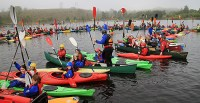 People on Kayaks and Canoes