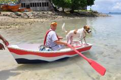 US Ambassador Tom Armbruster not only bought one of the dinghies made by the WAM trainees, he also rowed it home with his best friend Skipjack.
