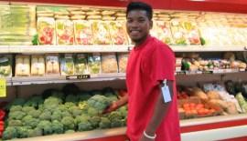 WAM 2015 alumni Jacklick Kamo work at K&K Supermarket. Photo: Tolina Tomeing
