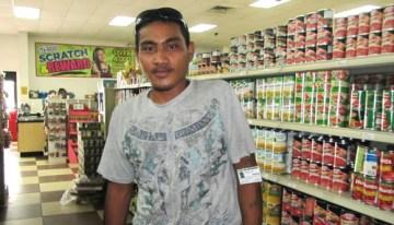 WAM 2015 alumni Jamison Jack working at the Payless Supermarket. Photo: Tolina Tomeing