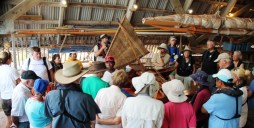 WAM's Binton Daniel gives visitors a talk on the traditional canoes. Photo: Joel Bowman