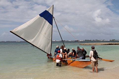 Peace Boat cruisers enjoy a canoe ride at WAM. Photo: Tolina Tomeing
