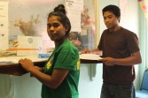 WAM Trainees Helenty Hemos and Jeson Lavine applying for birth certificates. Photo: Tolina Tomeing
