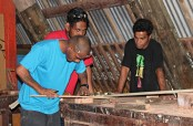 Picture frame construction by GEF Trainees Maston John and Rusty Riklon w/trainer Gregory Jokray. Photo: Sealend Laiden