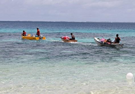 Trainees help with transport of provisions to Eneko. Photo: Suemina Bohanny